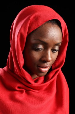 African American muslim girl in hijab looks down