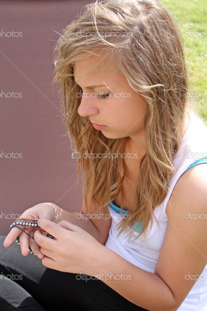 Beautiful Teenage Girl In Garden Stressed Out