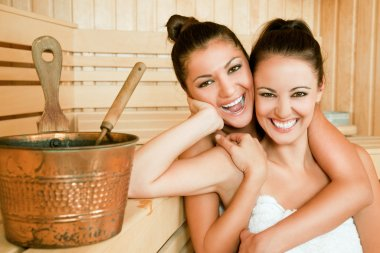 Females hugging sauna