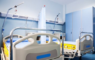 Hospital room rehabilitation beds