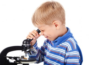 Five years old boy with microscope