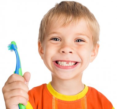 Boy without one teeth with toothbrush
