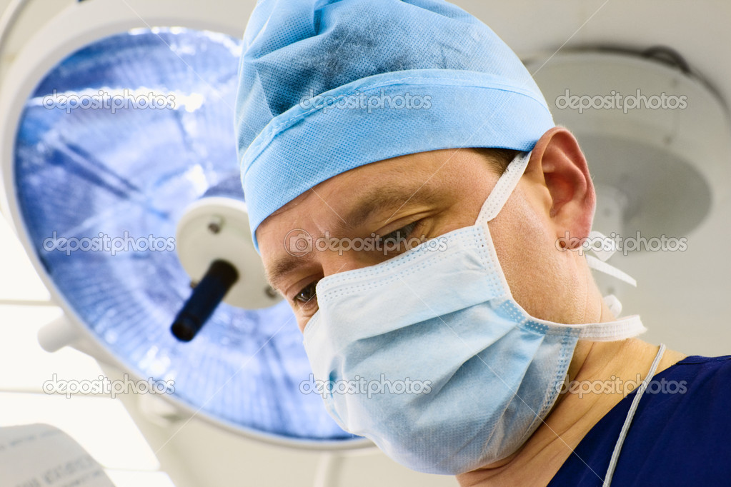Look of surgeon with lamp