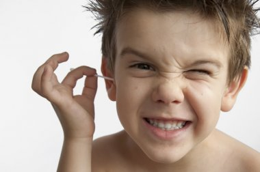 Boy cleans his ear