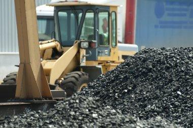 Excavator and coal piles