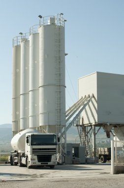 Cement factory and a truck loading cement