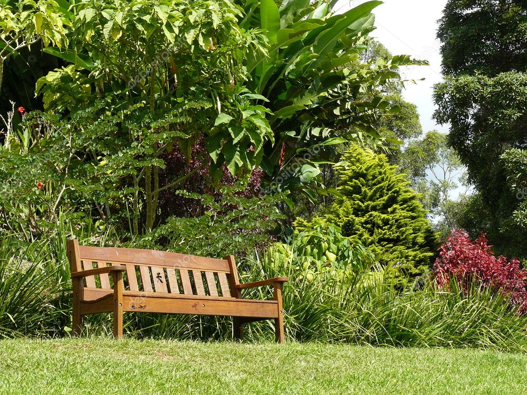 Sunny relaxing garden seat — Stock Photo © scarfe #6176364