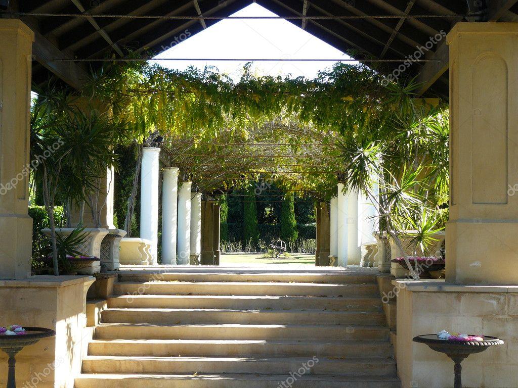 Romantic arbor in formal garden