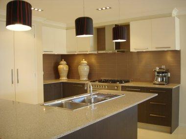 Modern kitchen warm tones open plan living