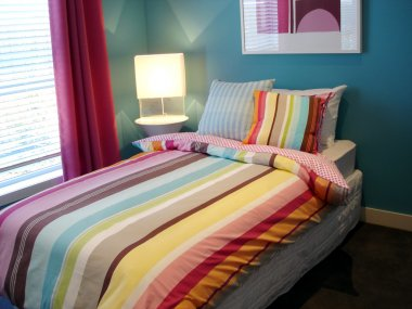 Vibrant blue and multi coloured bedroom