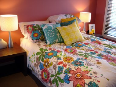 Vibrant red and multi coloured bedroom