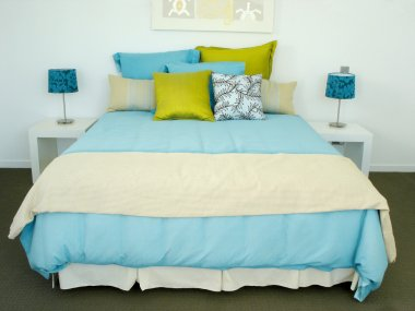 Blue and white and green bedroom
