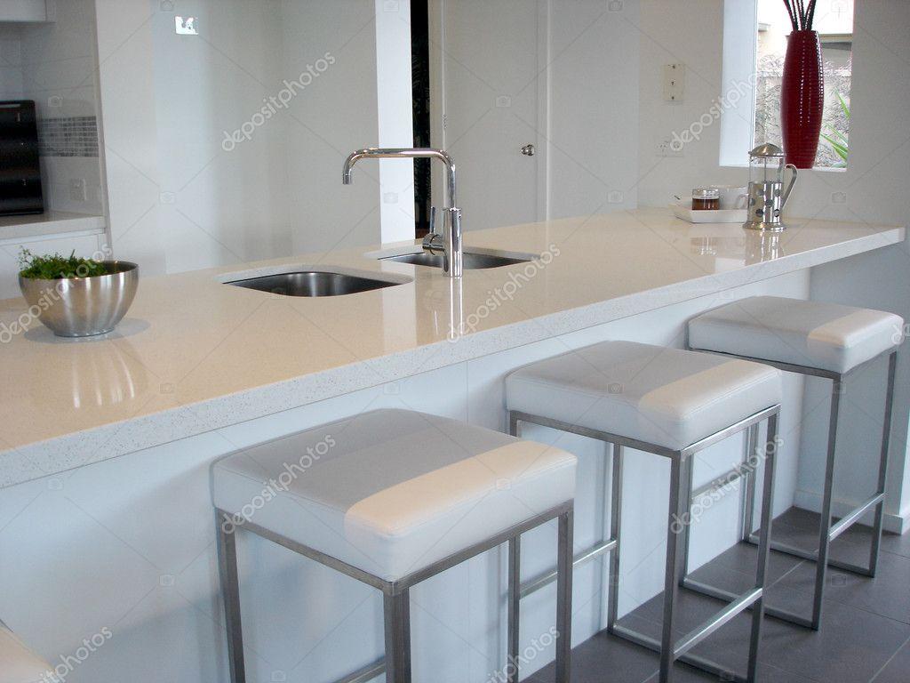 Spacious white open plan kitchen with breakfast bar — Stock Photo ...