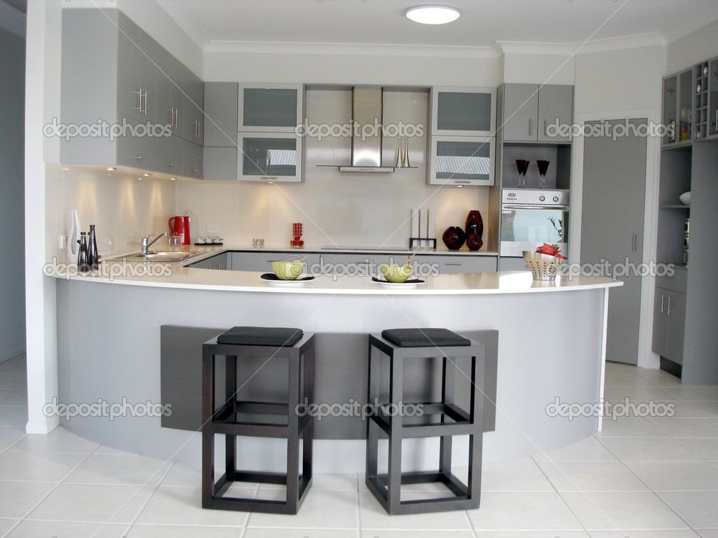 Spacious open plan kitchen with breakfast bar  Stock Photo scarfe