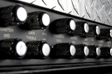 Black musical guitar amplifier panel