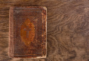 Very old aged brown bible on wooden table stock vector