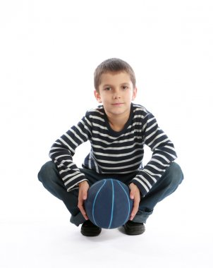 Boy holding a ball