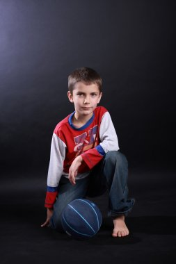 Boy of ten with a basketball ball