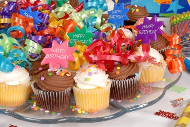 Closeup of a platter of cupcakes decorated with Happy Birthday t