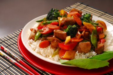 Plate of pork stir fry with vegetables