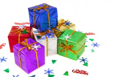 Several brightly colored Christmas gifts