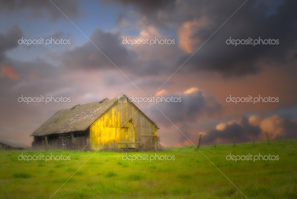 Old barn under dark skies with soft focus