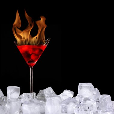 Burning alcoholic drink with ice cubes