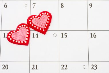 Two red hearts on a calendar background, date night stock vector
