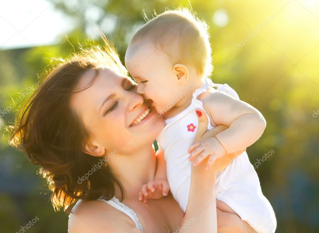 Happy mom and daughter smiling