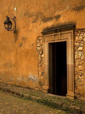 Yellow Brown Adobe Wall and Door Plus Lantern