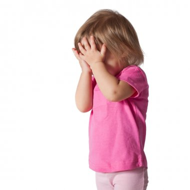 Girl with hands covering eyes playing hide and seek