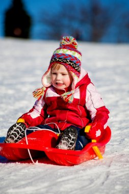 Winter activities. a girl sledding downhill stock vector