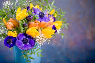 Bunch of anemones and tulips