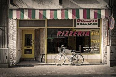 Facade of old pizzeria stock vector