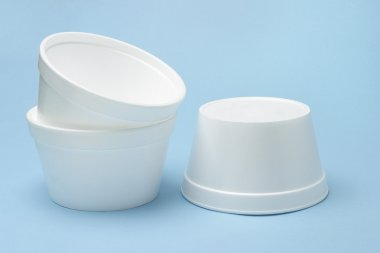 Three Styrofoam disposable bowls on seamless blue background stock vector
