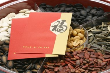 Chinese New Year red packets on snacks tray