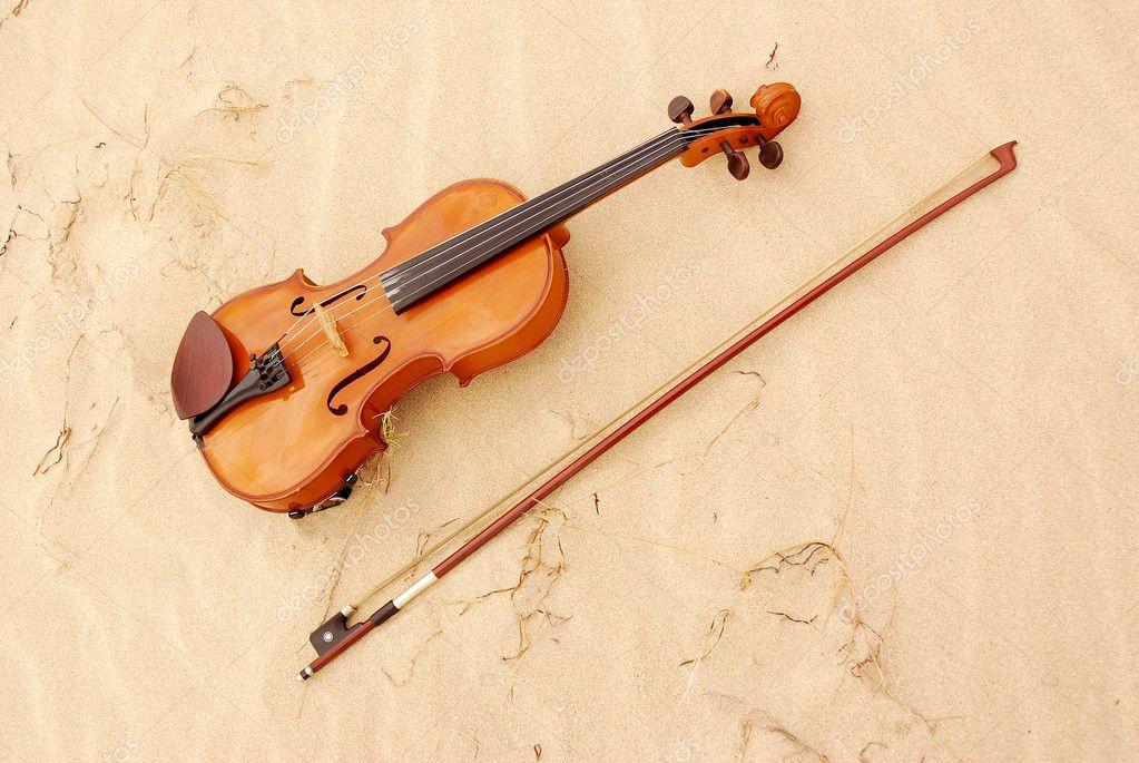 Violin in sand
