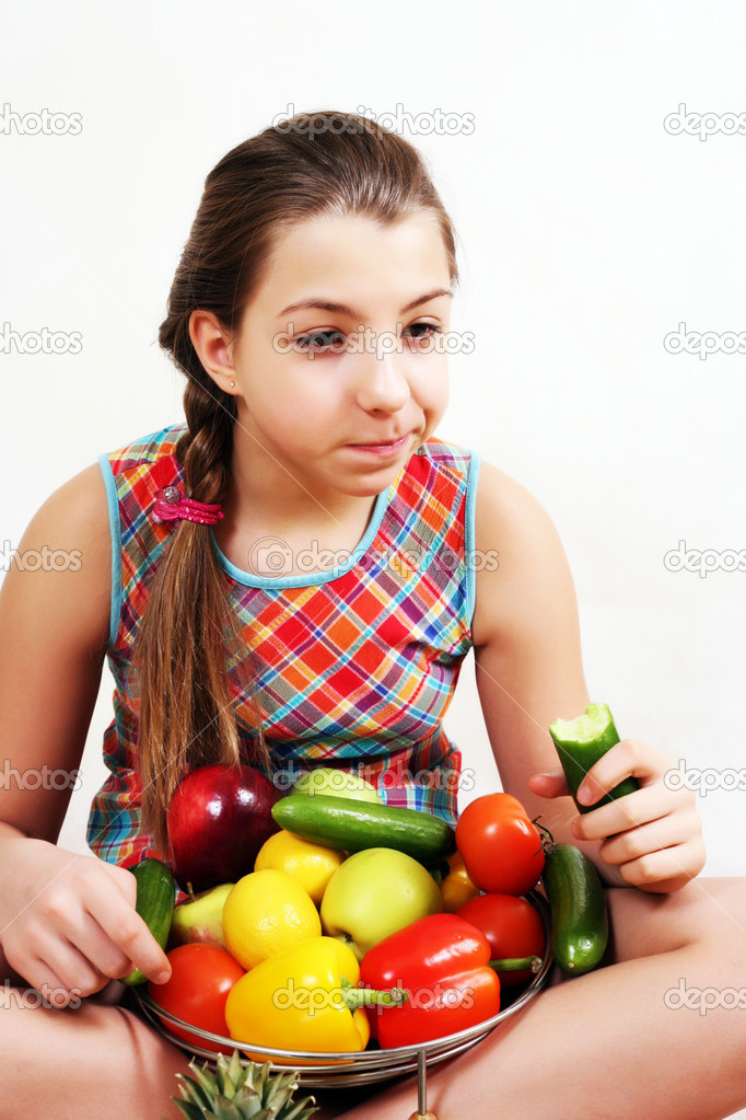 Girl teen covered with vegetables hard