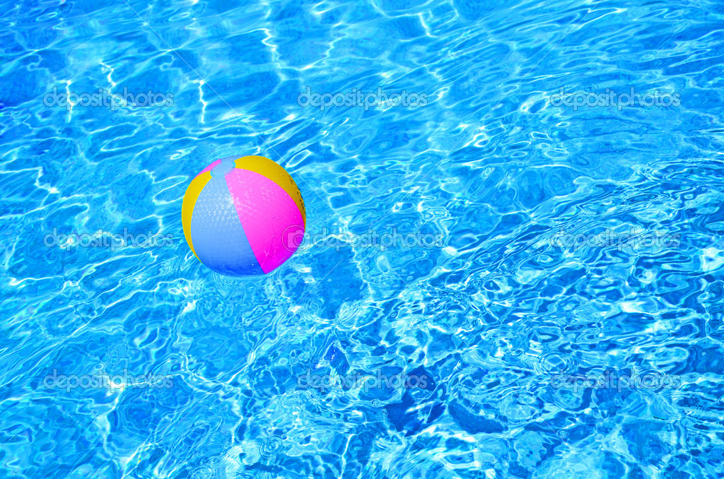 Pool Water With Beach Ball multicolored beach ball in swimming pool — stock photo © neftali77