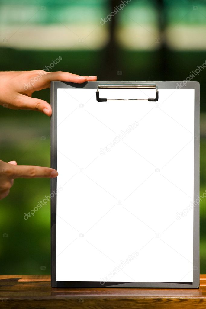The clipboard with a sheet of paper