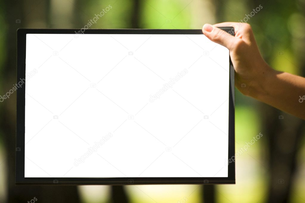 The clipboard with a sheet of paper in the hand