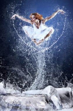 Jump of ballerina on the ice dancepool around splashes of water