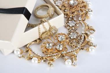 Box with Jewelry on a white background. Jewel. Pearl. Gold ring