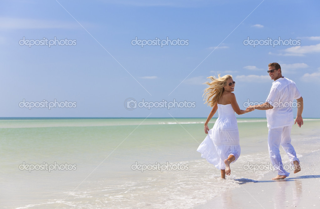 Happy Young Couple Running Holding Hands On A Tropical Beach Stock Photo 6482340