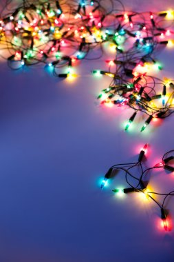 Christmas lights on dark blue background with copy space. Decora