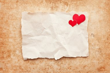 Ripped piece of paper on grunge paper background. Love letter