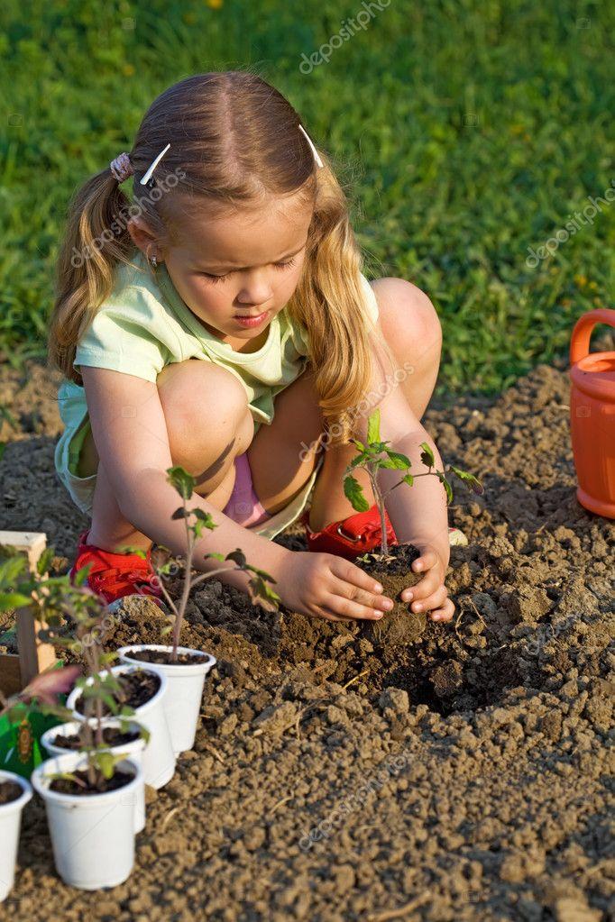 Little girl planting seedlings