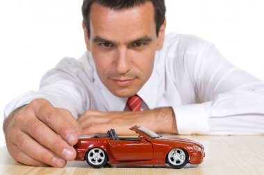 Man with red toy car