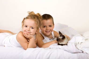 Happy kids with their kitten