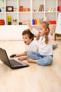 Excited kids about to win computer game